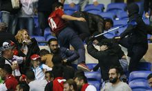 Besiktas and Lyon fans clash in the stands