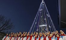 South Korean Christians sing a hymn in front of a Christmas tree on top of the Aegibong Peak Observat
