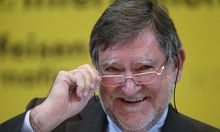 Raiffeisen Bank International CEO Herbert Stepic adjusts his glasses during a news conference in Vienna