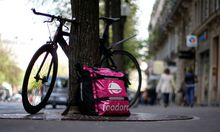 A bicycle and a delivery bag with the logo of Foodora a Berlin-based online food delivery company is seen in Paris