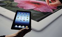A new Apple iPad is on display during an Apple event in San Francisco, Wednesday, March 7, 2012. The