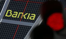 The headquarters of Spanish lender Bankia is pictured beside a red traffic light in Madrid