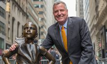 US NYC Mayor holds photo op with Fearless Girl Mayor De Blasio poses with the Fearless Girl sculptu