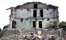 Ein zerstörtes Haus in Cavezzo.