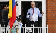 Wikileaks founder Julian Assange prepares to speak from the balcony of Ecuador´s embassy, where he is taking refuge in London