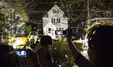 Neighbors use cameras to record images of the boat at 67 Franklin St. where Dzhokhar Tsarnaev, suspect in Boston Marathon bombings, was hiding inside in Watertown