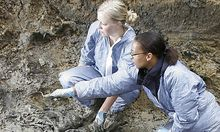 Forensic experts Renee Kosalka, of Toronto, Canada, left and Sharna Daley of London, Britain, inspect