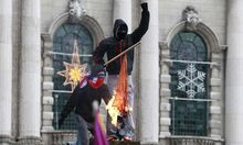 Protestors burn the Irish national flag in front of Belfast's City Hall