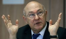 French Labour, Employment and Social Dialogue Minister Michel Sapin speaks during a meeting with journalists at Reuters offices in Paris