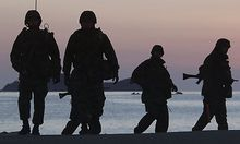 South Korean marines patrol along the beach of Yeonpyeong Island, South Korea, Friday, Dec. 10, 2010.