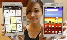 File photo of a model posing with Galaxy Note of Samsung Electronics during a local launch event for