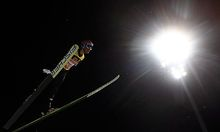 Kofler from Austria soars through the air during the qualification for the 60th four hill ski jumping