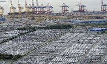 File photo of cars for export standing in shipping terminal at harbour in  Bremerhaven