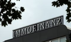 FILE PHOTO: The logo of Austrian real estate group Immofinanz is pictured on top of the company's headquarters building in Vienna