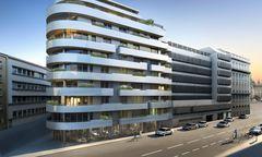 Schwungvolle Balkone statt strenger Fassade: Im ehemaligen Bürohaus entstehen Luxus- und Vorsorgewohnungen.