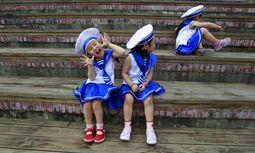 Taiwanesische Schulmädchen in Sailor-Moon-Kostümen.  / Bild: Reuters