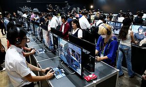 People play the video game ´Final Fantasy XV´ at Tokyo Game Show 2016 in Chiba