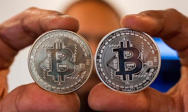 Die Kryptowährung Bitcoin lässt sich in der Realität zwar nicht angreifen - aber rauben. / Bild: APA/AFP/JACK GUEZ