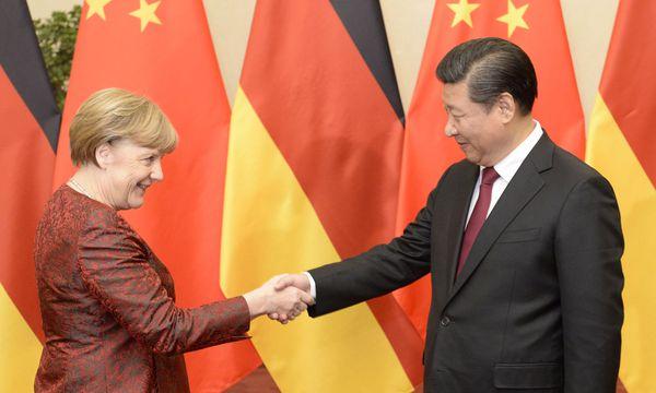 Angela Merkel und Xi Jinping - eine wirtschaftliche Nahebeziehung / Bild:  AFP (MUNEYOSHI SOMEYA)