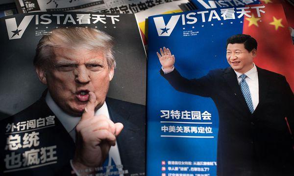Trump und Xi in chinesischen Medien. / Bild: APA/AFP/NICOLAS ASFOURI