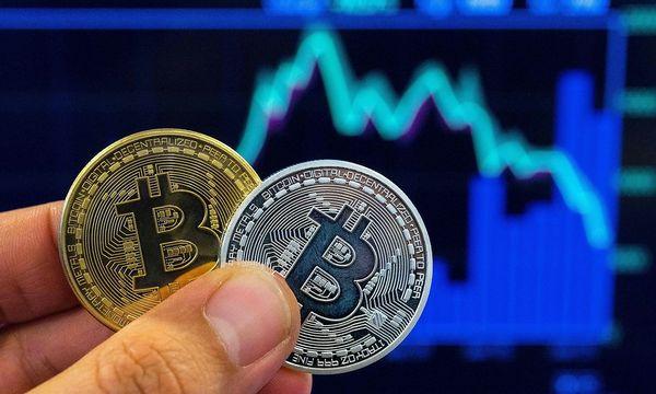 Bitcoin und andere Kryptowährungen verlieren. / Bild: APA/AFP/JACK GUEZ