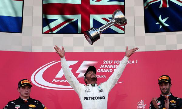 Hamilton jubelt in Suzuka. Wer hier gewinnt, wurde seit 2012 auch Weltmeister. / Bild: (c) APA/AFP/BEHROUZ MEHRI