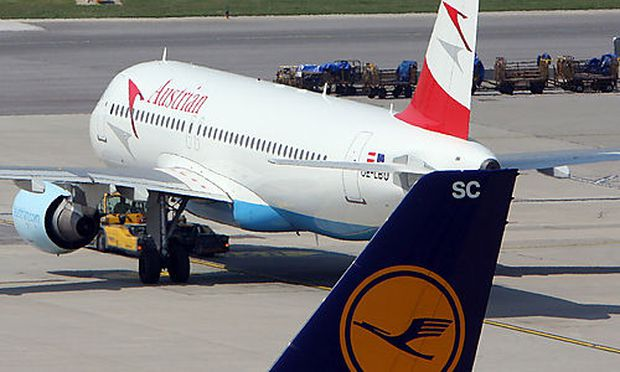 FILE - In this July 2, 2009, planes of Austrian Airlines, AUA, and Lufthansa stand at Vienna-Schwecha