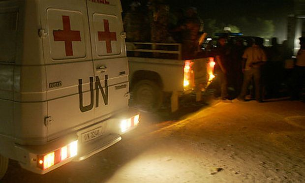 Jordanian U.N. peacekeepers stand next to an ambulance near the main highway that connects Port-au-Pr