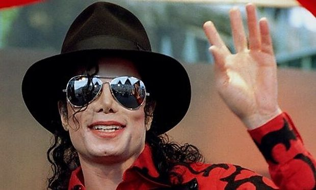 File photo of Michael Jackson waving to the crowd, numbering a few thousand, gathered in front of the