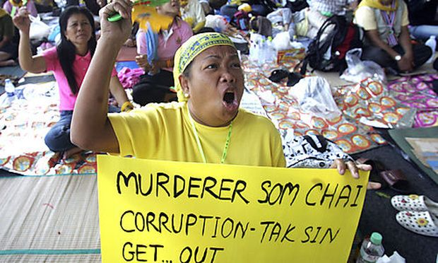 Anti-government protesters holds a poster during a rally at the Suvarnabhumi airport facility, Bangko