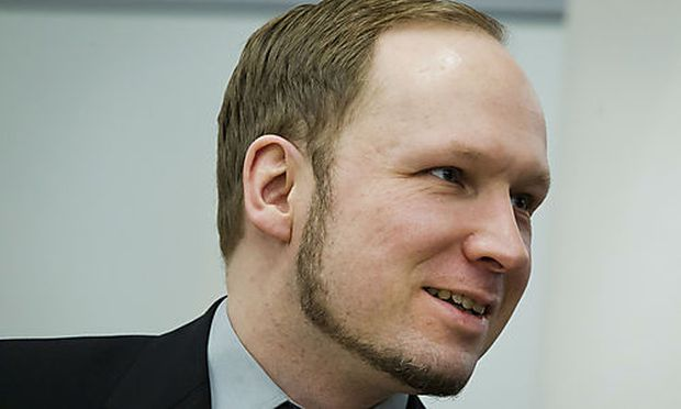 The self-styled, anti-Muslim militant Anders Behring Breivik, sits inside the court following an inci