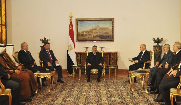 Handout photo of Egypt's President Mursi meeting with members of the OAPEC in Cairo