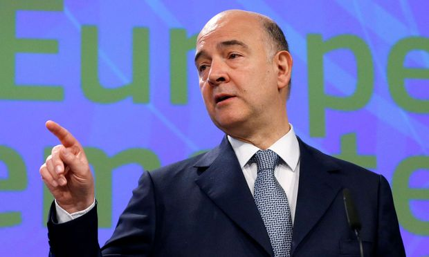 European Commissioner Moscovici addresses a news conference in Brussels