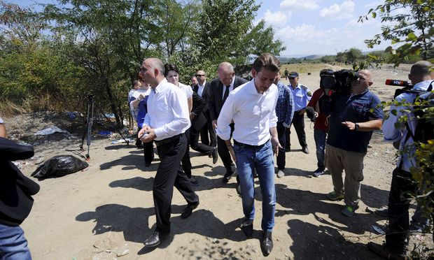 Macedonian Interior Minister Cavkov walks next to Austrian Foreign Minister Kurz at the Greek-Macedonian border line, near Gevgelija, in Macedonia