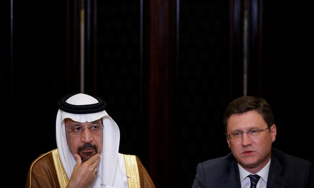 Saudi Arabia´s Energy Minister Khalid al-Falih and Russia´s Energy Minister Alexander Novak attend a joint briefing in Beijing