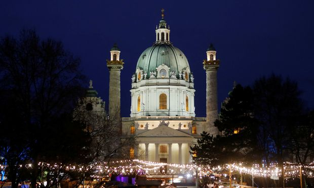 An advent market is seen in front of Karlskirche church in Vienna