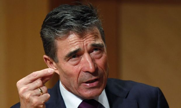 NATO Secretary General Fogh Rasmussen gestures while speaking after receiving the Hillary Rodham Clinton Award for Advancing Women in Peace and Security at Georgetown University in Washington