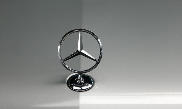 File photo of bonnet emblem of Mercedes-Benz car in dealership of German car manufacturer Daimler in Munich