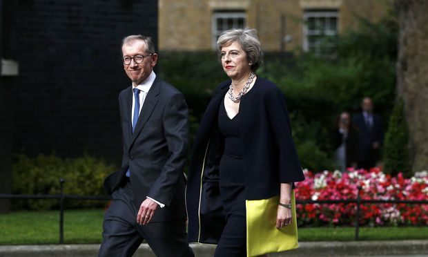 Britain´s Prime Minister, Theresa May, and husband Philip walk up Downing Street, in central London