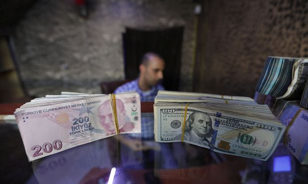 Banknotes of U.S. dollars and Turkish lira are seen in a currency exchange shop in the city of Azaz