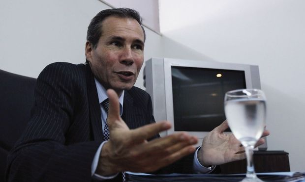 Argentine prosecutor Nisman, who is investigating the 1994 car-bomb attack on the AMIA Jewish community center, speaks during a meeting with journalists at his office in Buenos Aires