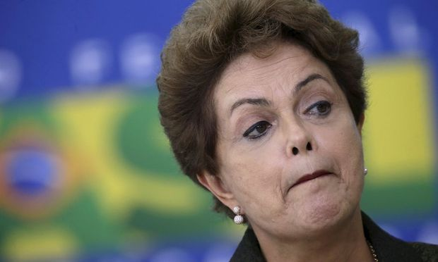 Brazil's President Rousseff reacts during the inauguration of the new Minister of Tourism Eduardo Alves at the Planalto Palace in Brasilia