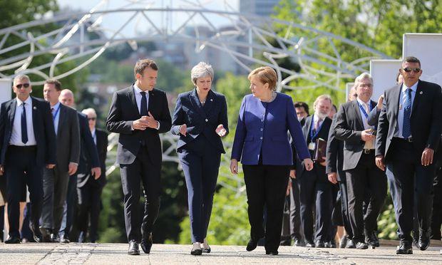 Die EU-Chefs Macron, May und Merkel (v. l.) wollen den von Trump gekündigten Iran-Deal retten.