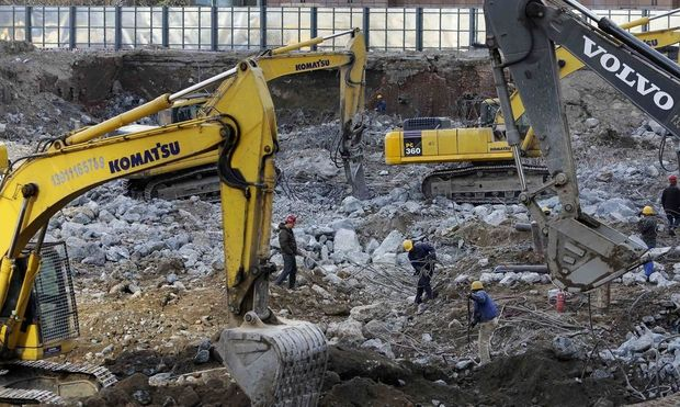 Labourers work at a construction site in Beijing
