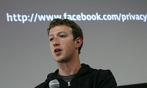 Facebook CEO Mark Zuckerberg responds to a question during a news conference at Facebook headquarters