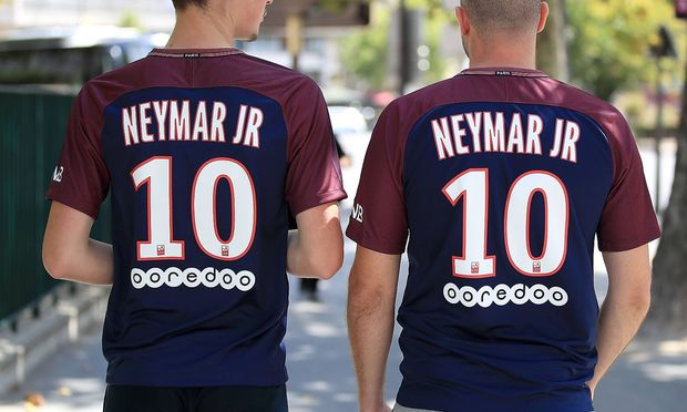 Paris Saint Germain s fans wearing shirts with new signing Neymar s name on their back prior to the