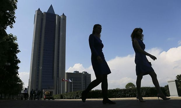 Women walk near Gazprom's main office in Moscow