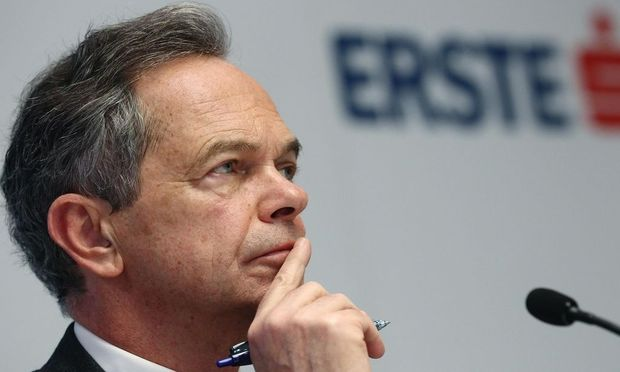 Treichl, CEO of Austrian lender Erste Group, listens during a news conference in Vienna