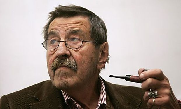 File photo of novelist Grass smoking pipe before the opening of an exhibition in Hamburg