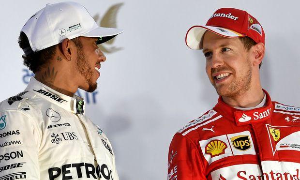 Sie dominieren die WM und ihre Teamkollegen: Hamilton (li.) und Vettel.